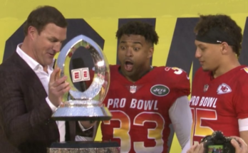 Jason Witten breaking the Pro Bowl trophy while simultaneously breaking his broadcast career. fantasy football